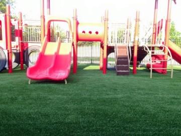 SoftLawn Emerald Rye ® | STI Playground Turf Installation